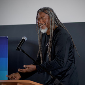 Jimmy Smith laughs during his keynote address at the Do More Good conference in Grand Rapids on Oct. 10