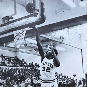 Jimmy Smith goes up for a shot for Mona Shores during a basketball game in his senior year against Muskegon. Smith is a 1980 graduate of Mona Shores High School.