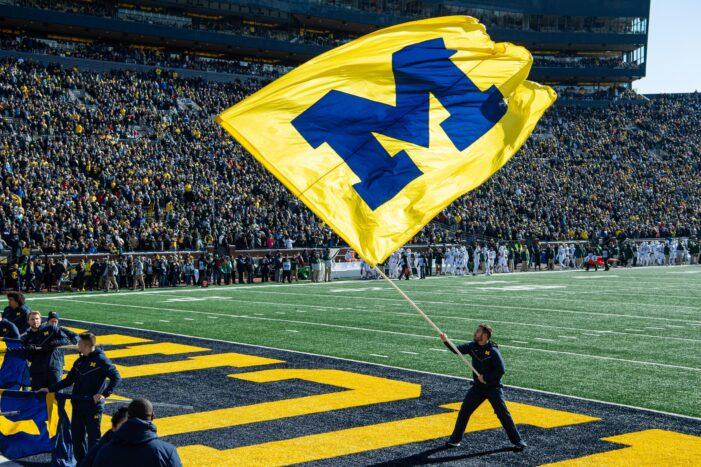 U. of Michigan hit with emergency stay-at-home order amid covid-19 spike. But the football team will play on.