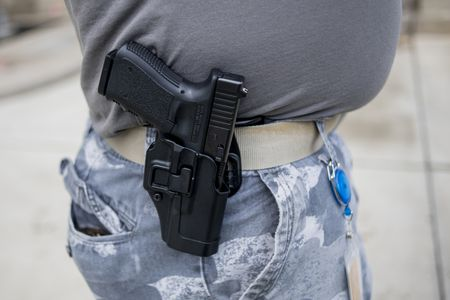 Michigan gun groups sue Benson to open carry at election polling sites